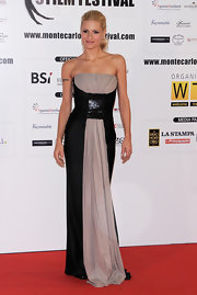 Michelle Hunziker's evening dress blended drapery a sleek tight-fitting feel all in one gown.