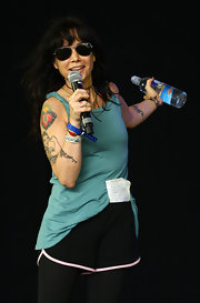 Janeane Garofalo performs on stage, and shows off her heart tattoo.