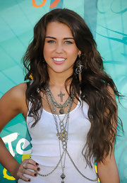 Miley Cyrus apmed up her white tank top with layered sterling silver necklaces.