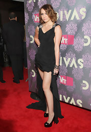 "Miley wisely went with the ""Tribute"" patent leather platforms for this affair. They really lengthen her legs."