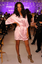 Selita struck a pose backstage at the the Victoria's Secret Fashion show in a pink robe and leopard-printed ankle boots.