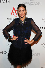 Olivia Palermo showed off her beaded bracelet while hitting the ACE Awards.
