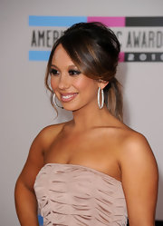 Cheryl Burke paired her strapless dress with a voluminous ponytail and side swept bangs.