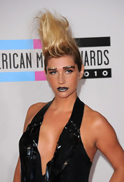 Kesha completed her faux hawk and studded eyebrows with silver metallic lipstick.