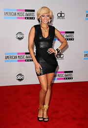 Keri adds some edge to a little black dress with snake skin. The singer paired this look with gold accessories.