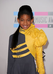Willow Smith showed off half up half down hairdo while attending the American Music Awards.