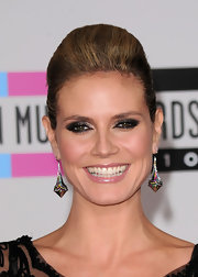 Heidi Klum paired her voluminous updo with metallic silver eyeshadow. She added drama to her look with black shadow at the outer corners.