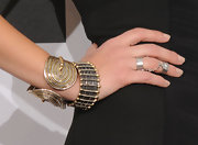 Actress Jessica Alba showed off her gold and silver cuff bracelets while attending the American Music Awards.