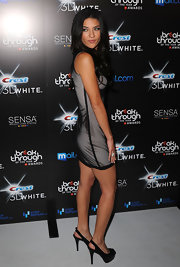 Jessica showed off her sexy stems in a sheer-overlaid mini dress with platform slingbacks.