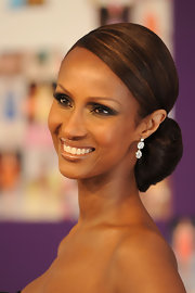 Iman glowed in a Giambattista Valli strapless gown, diamond drop earrings and a polished chignon updo.