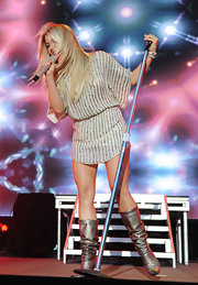 Julianne Hough performed in a pair of slouchy metallic mid-calf boots. She paired the pewter boots with a sequin-embellished mini dress.