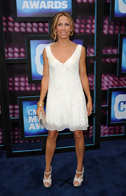 Sheryl Crow showed off her white cocktail dress while hitting the CMT Awards.