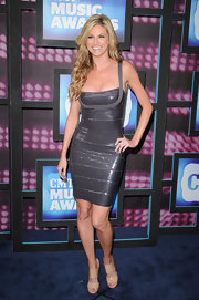 Erin Andrews showed off her sparkling dress while hitting the red carpet for the CMT Awards.