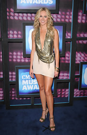 Laura sported a sexy metallic mini dress by the LA based designer, featuring a plunging neckline with bronze chain embellishments.