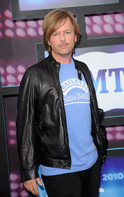 David Spade showed up at the CMT Awards donning a casual ensemble which he topped off with a leather jacket.