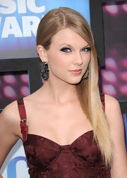 Taylor Swift topped her John Galiano dress off with large gemstone hoops.