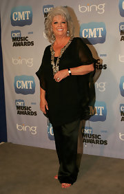 Paula Deen dressed up in a sheer black tunic with a shimmering neckline.