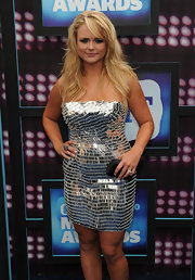 Miranda paired her silver frock with a black box clutch.