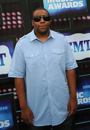 Kennan showed off his black shades while walking the red carpet at the CMT Awards.