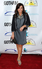 Rachael Ray paired a silver satin dress with gray suede platforms.