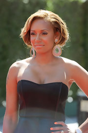 Mel B paired her decadent earrings with a loose updo.