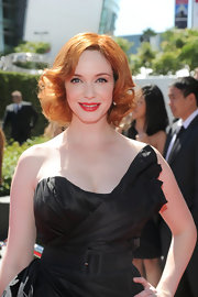 Christina showed off her fiery red bob, which was full of voluminous curls.