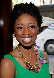 Actress Montego Glover showed off her muti-beaded necklace while attending the 2010 Drama Desk Awards.