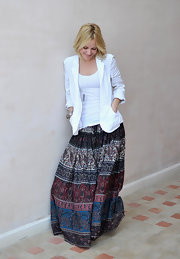 Emma looks absolutely lovely in a long print skirt and white blazer.