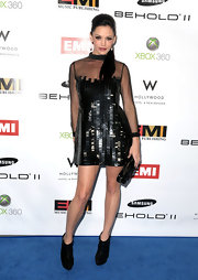 Jessica Sutta was oozing with hotness at the EMI Grammy party wearing a sequined cocktail dress with sheer sleeves.