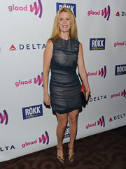 Alex wore a sheer overlaid cocktail dress with metallic ankle-strap sandals.