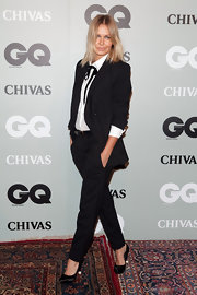 Lara Bingle looked sultry in black satin pumps. She paired the heels with a tailored menswear for a perfectly androgynous look.