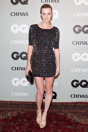 Gracie Otto paired her dazzling embellished mini dress with a  black and gray textured clutch. A sleek hairstyle and nude heels perfectly complement the sultry look.