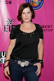 Marcia Gay Harden styled her jeans with a triple beaded buckled belt at a charity gala.