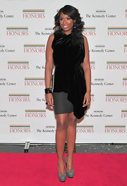 Jennifer Hudson paired a velvet cocktail dress with gray platform pumps.