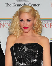 Gwen Stefani added a little bounce to her blond locks. The singer sported soft spiral curls that were elegantly pinned into place.