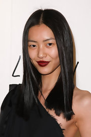 Liu Wen vamped it up with dark red lipstick.