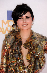 Here, Hanna Beth's nose ring complements her metallic dress.