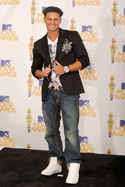 Pauly rocked pristine white high top sneakers with True Religion jeans and an embellished blazer.