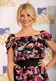 Cameron Diaz paired her abstract print dress with a loose classic bun.