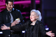 Bradley Cooper (L) and Betty White speak onstage at the 2010 MTV Movie Awards held at the Gibson Amphitheatre at Universal Studios  on June 6, 2010 in Universal City, California.