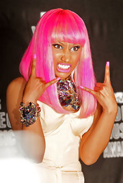 Nicki Minaj perfectly matched her hot pink bob with bubble gum pink nail polish.