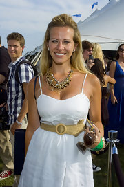 Dina paired her summer white dress with gold layered necklaces.