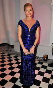 Simona Ventura looked tantalizing in a curve-hugging beaded blue gown.