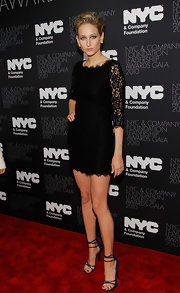 Leelee Sobieski is all legs in strappy blue stilettos. The sensational sandals looked unexpectedly fabulous with her on-trend lace mini dress.