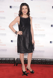 Julianna wore a metallic shift dress with sparkling black sling backs.