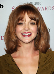 Jayma Mays showed off her glamorous side in a cranberry shade of red lipstick.