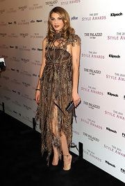 Angela Lindvall donned classic black suede pumps with a avant-garde feathered knit dress to the 2010 Style Awards.