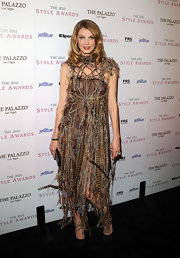 Angela opts for an unusual red carpet choice in this feather embellished evening dress.