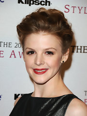 Ashley Bell vamped up her elegant updo with a splash of red lipstick.