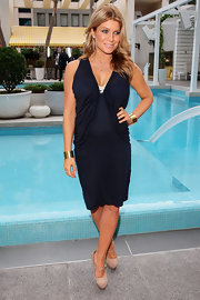 Natalie Bassingthwaighte posed by the pool at the 2010 TV Week Logie Awards Nominations wearing a navy blue draped knee-length dress.